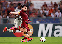 Calcio, Champions League, Gruppo E: Roma vs CSKA Mosca. Roma, stadio Olimpico, 17 settembre 2014.<br /> CSKA Moskva forward Ahmed Musa, of Nigeria, left, and Kostas Manolas fight for the ball during the Group E Champions League football match between AS Roma and CSKA Moskva at Rome's Olympic stadium, 17 September 2014.<br /> UPDATE IMAGES PRESS/Isabella Bonotto