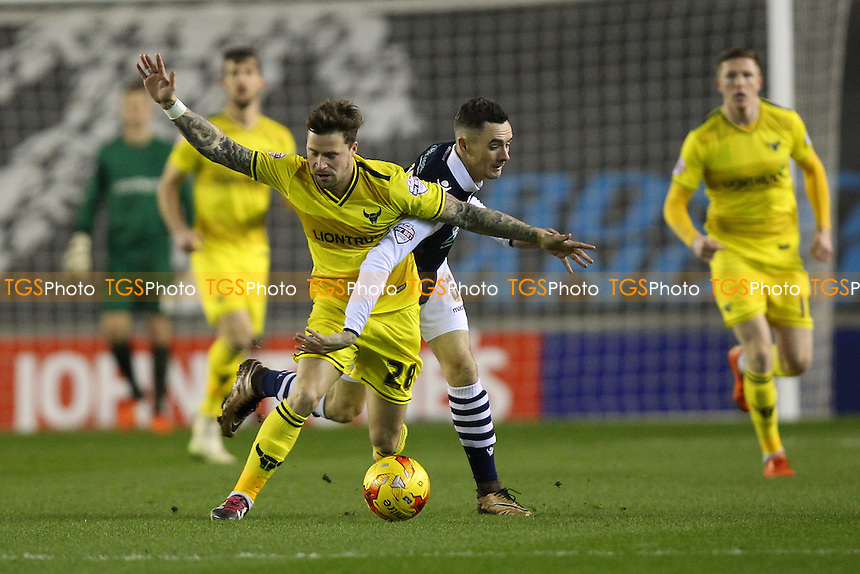 Chris Maguire of Oxford United tangles with Shaun Williams of Millwall during Millwall vs Oxford United at The Den