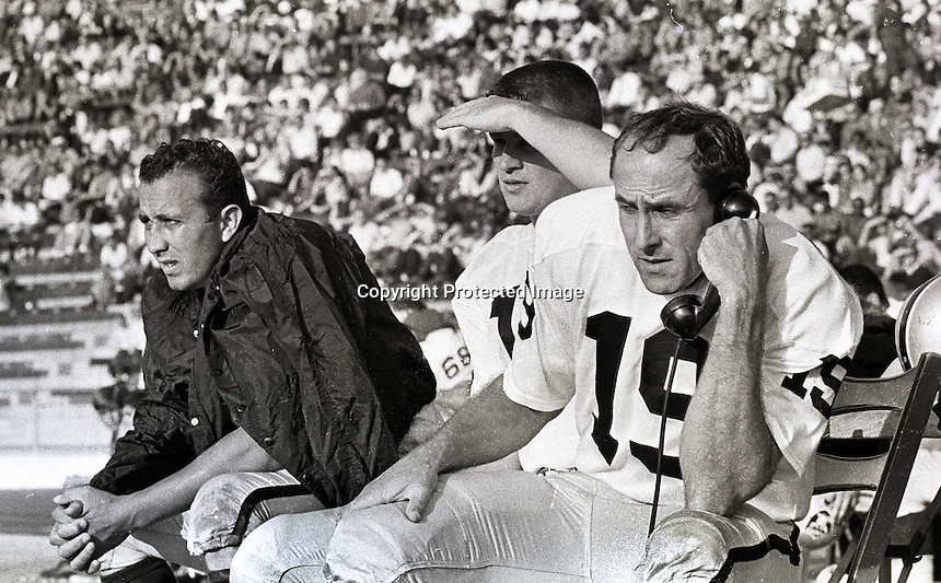 Raider QB's Tom Flores (left) and Cotten Davidson on the phones..playing at Frank Youell field in Oakland, 1963. photo by Ron Riesterer
