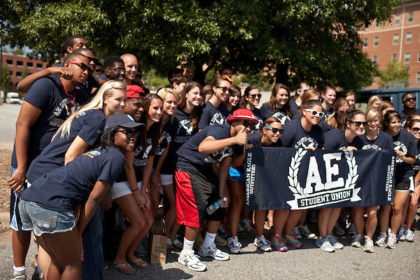 """August 20, 2011. Chapel Hill, NC.. American Eagle """"brand ambassadors"""" and volunteers pose for a photo before before heading out to spread awareness of the brand by helping incoming students with their stuff and giving away coupons on move in day.. Many companies have increased their efforts to reach the youth market by employing popular college students to raise the awareness of the brand by peer to peer marketing on campus' around the country."""