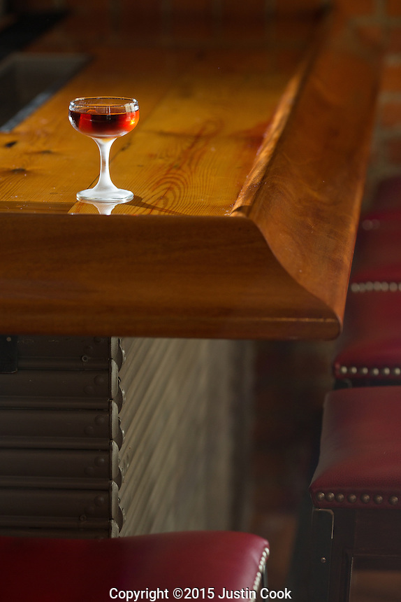 The Martinez (Beefeater's Gin, Punt e Mes Vermouth, Maraschino liquor, orange bitters, lemon) on a reclaimed wood bar (from the original building) at Bar Virgile in Durham, North Carolina on Tuesday, January 6, 2015. (Justin Cook)