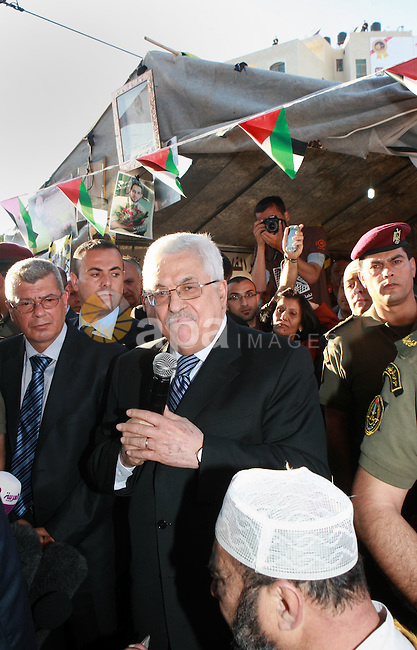 Palestinian President Mahmoud Abbas (Abu Mazen), visits the sit-in tent held by Palestinians, in the West Bank, city of Ramallah solidarity with Palestinian prisoners on hunger strike held in Israeli jails, on May 10, 2012. Photo by Thaer Ganaim