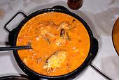 Recife, Brazil. Muqueca de Peixe fish stew in an earthenware dish.