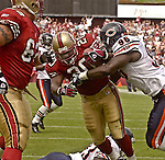 Chicago Bears defensive end Alex Brown (96) tackles San Francisco 49ers running back Garrison Hearst (20) as he makes touchdown in second quarter on Sunday, September 7, 2003, in San Francisco, California. The 49ers defeated the Bears 47-7.