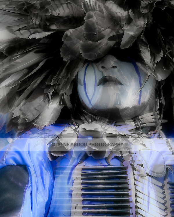 "Eagle Tail, a Native American from the Micmac Indian Tribe of Canada, dances at the 8th Annual Red Wing Native American Pow Wow in Virginia Beach, VA.  His face paint was ""gifted"" to him by his grandfather."