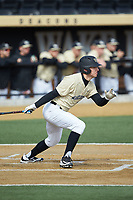 Nick DiPonzio (7) of the Wake Forest Demon Deacons follows through on his swing against the Louisville Cardinals at David F. Couch Ballpark on March 18, 2018 in  Winston-Salem, North Carolina.  The Demon Deacons defeated the Cardinals 6-3.  (Brian Westerholt/Four Seam Images)