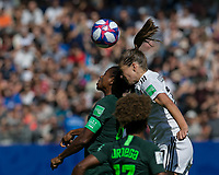 GRENOBLE, FRANCE - JUNE 22: Desire Oparanozie #9 of the Nigerian National Team, Melanie Leupolz #18 of the German National Team battle for head ball during a game between Panama and Guyana at Stade des Alpes on June 22, 2019 in Grenoble, France.