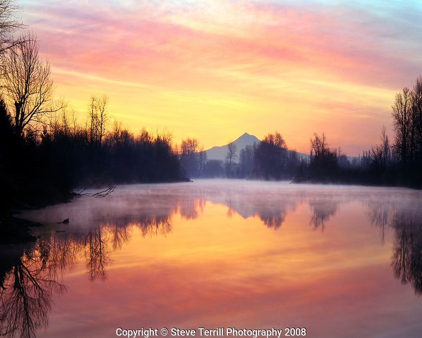 Clouds above Mt. Hood reflecting in the Columbia Slough at sunrise in Multnomah County, Oregon