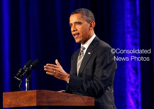 United States President Barack Obama speaks at a Democratic National Committee event in Washington, DC on Tuesday, December 13, 2011.  .Credit: Dennis Brack / Pool via CNP