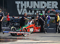 Jun 16, 2017; Bristol, TN, USA; Crew members for NHRA top fuel driver Kebin Kinsley during qualifying for the Thunder Valley Nationals at Bristol Dragway. Mandatory Credit: Mark J. Rebilas-USA TODAY Sports