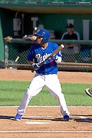 Jaylen Harris (5) of the Ogden Raptors at bat against the Grand Junction Rockies on June 19, 2014 at Lindquist Field in Ogden, Utah. (Stephen Smith/Four Seam Images)