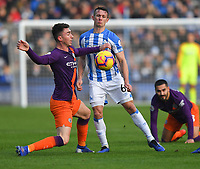 Huddersfield Town's Jonathan Hogg battles with Manchester City's Aymeric Laporte<br /> <br /> Photographer Dave Howarth/CameraSport<br /> <br /> The Premier League - Huddersfield Town v Manchester City - Sunday 20th January 2019 - John Smith's Stadium - Huddersfield<br /> <br /> World Copyright © 2019 CameraSport. All rights reserved. 43 Linden Ave. Countesthorpe. Leicester. England. LE8 5PG - Tel: +44 (0) 116 277 4147 - admin@camerasport.com - www.camerasport.com