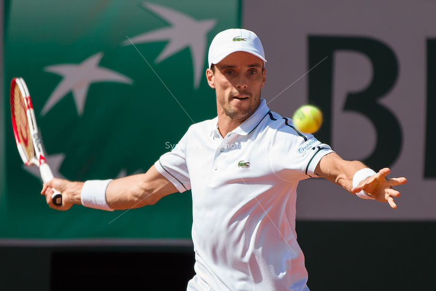 May 24, 2015: Roberto Bautista Agut of Spain in action in a 1st round match against Florian Mayer of Germany on day one of the 2015 French Open tennis tournament at Roland Garros in Paris, France. Bautista Agut won 63 61 63. Sydney Low/AsteriskImages