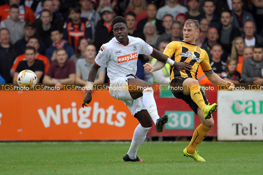 Pelly Ruddock Mpanzu (Luton Town) and Richard Tait (Cambridge United) go for the ball - Cambridge United vs Luton Town - Sky Bet League Two Football at the Abbey Stadium, Cambridge - 20/09/14 - MANDATORY CREDIT: Mick Kearns/TGSPHOTO - Self billing applies where appropriate - contact@tgsphoto.co.uk - NO UNPAID USE