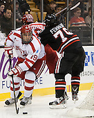 Wade Megan (BU - 18), Alexx Privitera (BU - 6), Cody Ferriero (NU - 79) - The Northeastern University Huskies defeated the Boston University Terriers 3-2 in the opening round of the 2013 Beanpot tournament on Monday, February 4, 2013, at TD Garden in Boston, Massachusetts.
