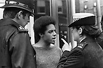 Police give a warning to a black British youth. Sloane Square, Kings Road, Chelsea, London. England. 1977.
