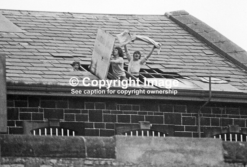 Loyalist remand prisoners at Crumlin Road Jail, Belfast, N Ireland, broke through the roof of their wing so that they could see Orangemen parade past the prison on their way to the main procession.  197307120504a<br />