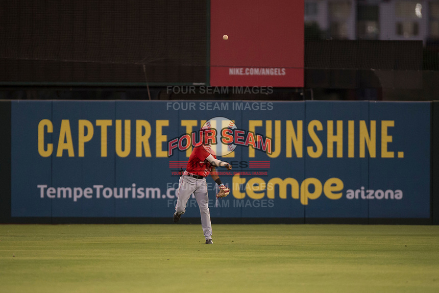 AZL Angels center fielder Jordyn Adams (21) makes a throw to the infield during an Arizona League game against the AZL Padres 2 at Tempe Diablo Stadium on July 18, 2018 in Tempe, Arizona. The AZL Padres 2 defeated the AZL Angels 8-1. (Zachary Lucy/Four Seam Images)