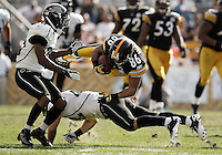 PITTSBURGH, PA - OCTOBER 16:  Hines Ward #86 of the Pittsburgh Steelers is upended by members of the Jacksonville Jaguars after catching a pass during the game on October 16, 2011 at Heinz Field in Pittsburgh, Pennsylvania.  (Photo by Jared Wickerham/Getty Images)