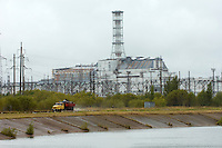 Reactors 3 and 4 (with sarcophagus) at the Chernobyl Nuclear Power Plant.<br /> The sarcophagus around reactor 4 was erected after the disaster on April 26 1986. The area is today contamined with nuclear material, the half-life of plutonium-239 is more than 24.000 years.<br /> Chernobyl, Ukraine.<br /> August 2008.