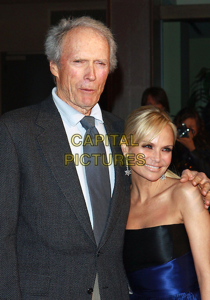 CLINT EASTWOOD & KRISTIN CHENOWETH .Annual Backstage At The Geffen Gala -Arrivals held at The Geffen Playhouse, Westwood, California, USA, .22nd March 2010..half length black jacket grey gray shirt tie blue strapless arm around shoulder smiling mouth funny open .CAP/ADM/TC.©T. Conrad/AdMedia/Capital Pictures.
