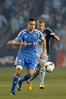 Davy Arnaud (22) midfield   Montreal Impact pursued by Oriol Rosell (20) midfield Sporting KC..Sporting Kansas City defeated Montreal Impact 2-0 at Sporting Park, Kansas City, Kansas.