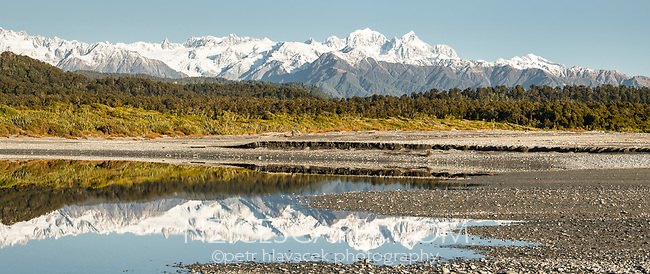 Mount Tasman 3497m and Aoraki Mount Cook 3724m reflecting in coastal lagoon, Westland Tai Poutini National Park, West Coast, UNESCO World Heritage Area, New Zealand, NZ
