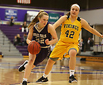 SIOUX FALLS, SD - DECEMBER 31: Lauren Sanders #32 from the University of Sioux Falls drives to the basket against Naomi Rust #42 from Augustana University during their game Sunday afternoon December 31, 2017 at the Stewart Center in Sioux Falls. (Photo by Dave Eggen/Inertia)