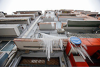 Pictured: Water has frozen on balconies of a block of flats in central Salonika, Greece. Monday 09 January 2017<br /> Re: Severe cold weather affects Salonica in northern Greece