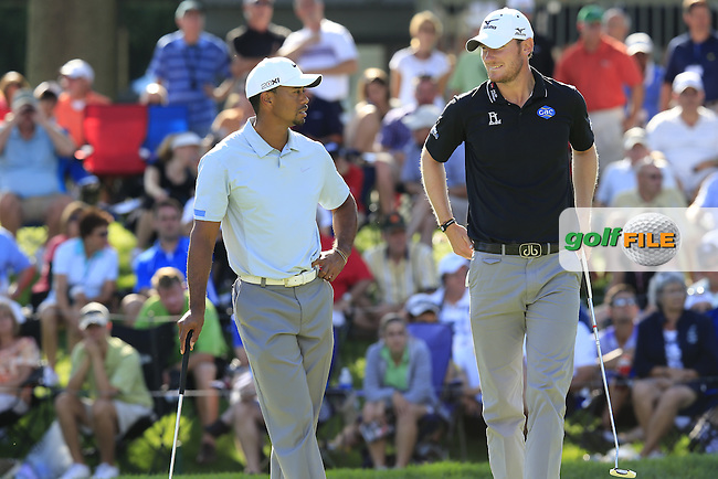 Tiger Woods (USA) and Chris Wood (ENG) chat on the 16th green during Saturday's Round 3 of the 2013 Bridgestone Invitational WGC tournament held at the Firestone Country Club, Akron, Ohio. 3rd August 2013.<br /> Picture: Eoin Clarke www.golffile.ie