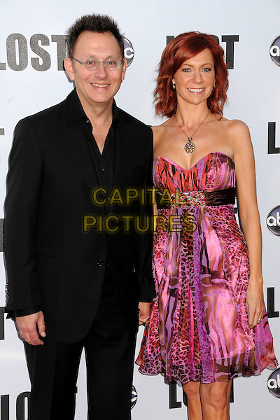 "MICHAEL EMERSON & CARRIE PRESTON.""Lost"" Live: The Final Celebration held at UCLA's Royce Hall, Westwood, California, USA..May 13th, 2010.half length suit jacket strapless pink red dress leopard print black glasses married husband wife .CAP/ADM/BP.©Byron Purvis/AdMedia/Capital Pictures."
