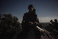 In this Wednesday, Sep. 18, 2013 photo, a Syrian opposition fighter is seen at the top of a mountain that surrounds  a rebel camp in the Idlib province countryside, Syria. (Photo/AP).