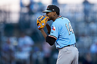Hickory Crawdads starting pitcher Tyree Thompson (14) looks to his catcher for the sign against the Ocelotes de Greensboro at First National Bank Field on June 11, 2019 in Greensboro, North Carolina. The Crawdads defeated the Ocelotes 2-1. (Brian Westerholt/Four Seam Images)