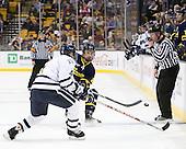 Damon Kipp (UNH - 4), Brendan Ellis (Merrimack - 22), Chris Millea - The Merrimack College Warriors defeated the University of New Hampshire Wildcats 4-1 (EN) in their Hockey East Semi-Final on Friday, March 18, 2011, at TD Garden in Boston, Massachusetts.