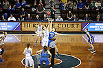 SIOUX FALLS MARCH 23:  Kellyn Schneider #13 from Lubbock Christian jump the opening tip with Victoria Lux #32 from Bentley University during their 2016 NCAA Women's DII Elite 8 Basketball Championship semifinal Wednesday night at the Sanford Pentagon in Sioux Falls, S.D. (Photo by Dave Eggen/Inertia)