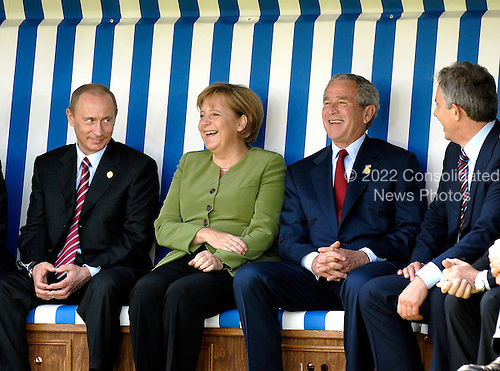 Heiligendamm, Germany - June 7, 2007 -- Chancellor Angela Merkel of Germany, left center, sitting in a wicker beach chair during a photo opportunity at the G-8 Meeting of Heads of State and Government in Heiligendamm, Germany on Thursday, June 7, 2007 with President Vladimir Putin of Russia, left, United States George W. Bush, right center, and Prime Minister Tony Blair of the United Kingdom..Credit: BPA via CNP