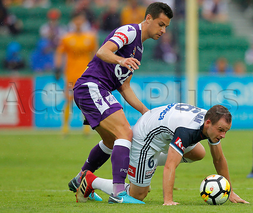 25th March 2018, nib Stadium, Perth, Australia; A League football, Perth Glory versus Melbourne Victory; Leigh Broxham of Melbourne Victory is fouled by the challenge from Joel Chianese of the Perth Glory during the first half