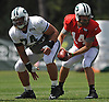 Ryan Fitzpatrick #14, New York Jets starting quarterback, right, takes a snap from center #74 Nick Mangold during team training camp at Atlantic Health Jets Training Center in Florham Park, NJ on Friday, Aug. 5, 2016