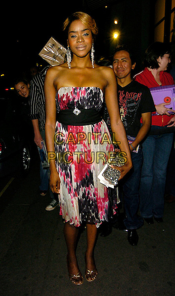 "ANTONIA OKONMA.""You, Me & Dupree"" UK film premiere, Odeon, Leicester Square, London, UK..August 22nd, 2006.Ref: CAN.full length pink purple white pattern strapless dress black belt silver clutch purse.www.capitalpictures.com.sales@capitalpictures.com.©Can Nguyen/Capital Pictures"