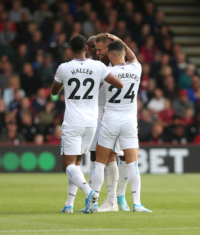 West Ham United's Andriy Yarmolenko is congratulated after scoring his side's first goal<br /> <br /> Photographer Rob Newell/CameraSport<br /> <br /> The Premier League - Bournemouth v West Ham United - Saturday 28th September 2019 - Vitality Stadium - Bournemouth<br /> <br /> World Copyright © 2019 CameraSport. All rights reserved. 43 Linden Ave. Countesthorpe. Leicester. England. LE8 5PG - Tel: +44 (0) 116 277 4147 - admin@camerasport.com - www.camerasport.com