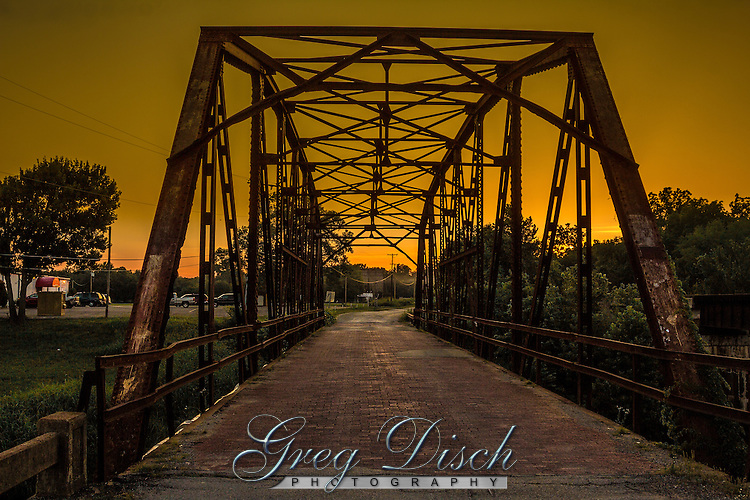 The Rock Creek Bridge or Bridge #18 at Sapulpa Oklahoma, is a Parker through truss bridge.  Unusual for a steel truss bridge, #18 has brick decking.&nbsp;<br /> <br /> Bridge #18 is an illustration of the bridges of its era. Route 66 travelers who crossed Rock Creek near Sapulpa during the late 1920s would have thought the bridge the most dynamic design of its time, and it was. &nbsp;Constructed in 1924, #18 served as part of the old Ozark Trail, one of the few marked U. S. roads at the time. It became part of Route 66 in 1926. Just over a decade later the State&rsquo;s entire section of Route 66 was paved. The bridge served Route 66 until the construction of a new alignment in 1952. The bridge was listed in the National Register of Historic Places in 1995.