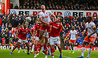 Blackpool's Ben Heneghan nods on a throw in under pressure from Barnsley's Mike Bahre<br /> <br /> Photographer Alex Dodd/CameraSport<br /> <br /> The EFL Sky Bet League One - Barnsley v Blackpool - Saturday 27th April 2019 - Oakwell - Barnsley<br /> <br /> World Copyright © 2019 CameraSport. All rights reserved. 43 Linden Ave. Countesthorpe. Leicester. England. LE8 5PG - Tel: +44 (0) 116 277 4147 - admin@camerasport.com - www.camerasport.com