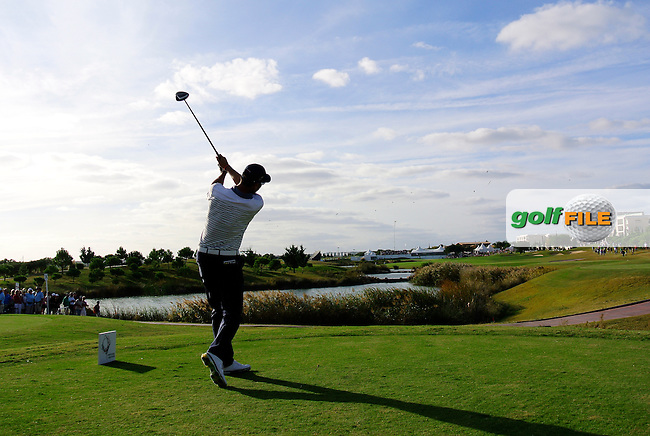 Alvaro Quiros (ESP) tees off the 18th tee during Saturday's Round 3 of the 2013 Portugal Masters held at the Oceanico Victoria Golf Club. 12th October 2013.<br /> Picture: Eoin Clarke www.golffile.ie