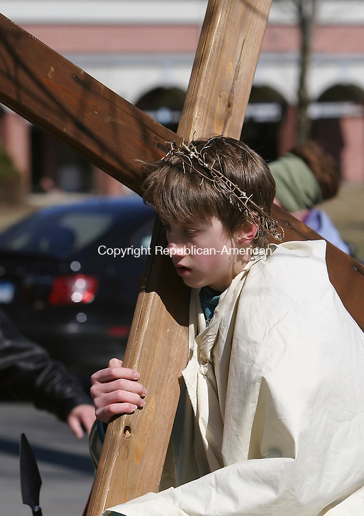 SOUTHBURY, CT 03/21/08- 032108BZ07- Trevor Ferraro, portraying Jesus, carries a cross while leading the annual Good Friday Faith Walk in Southbury.  More than 400 people walked in the procession along Main Street South reenacting the stations of the cross along the way to Sacred Heart Church.<br /> Jamison C. Bazinet Republican-American