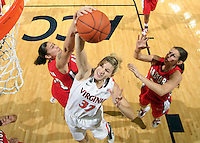 Dec. 6, 2010; Charlottesville, VA, USA; Virginia Cavaliers forward Jayna Hartig (32) grabs a rebound in front of Radford Highlanders guard Erica Rivera (23) and Radford Highlanders guard Kaylyn Crosier (31) at the John Paul Jones Arena. Virginia won 76-52. Mandatory Credit: Andrew Shurtleff-