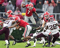 ATHENS, GA - NOVEMBER 23: D'Andre Swift #7 of the Georgia Bulldogs attempts to leap over defenders during a game between Texas A