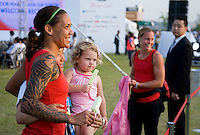 Natasha Kai and Rylie Rampone pose with a fan as Christie Rampone  looks on during the Peace Queen Cup Welcome Reception in Suwon, South Korea.