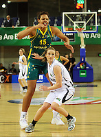 175cm Tall Ferns guard Erin Rooney is dwarfed by 203cm Opals forward Elizabeth Cambage during the International women's basketball match between NZ Tall Ferns and Australian Opals at Te Rauparaha Stadium, Porirua, Wellington, New Zealand on Monday 31 August 2009. Photo: Dave Lintott / lintottphoto.co.nz