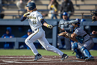 Michigan Wolverines outfielder Jordan Brewer (22) follows through on his swing against the San Jose State Spartans on March 27, 2019 in Game 1 of the NCAA baseball doubleheader at Ray Fisher Stadium in Ann Arbor, Michigan. Michigan defeated San Jose State 1-0. (Andrew Woolley/Four Seam Images)