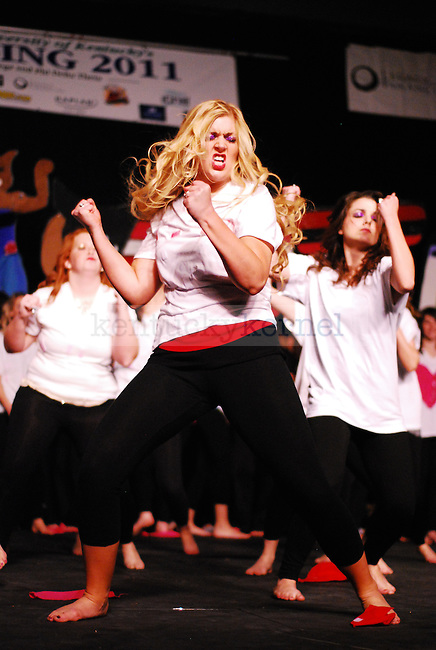 An Alpha Omicron Pi sister dances in the 2011 Greek Sing event held at Memorial Coliseum in Lexington, Ky. on Feb. 5, 2011. Photo by Ryan Buckler | Staff